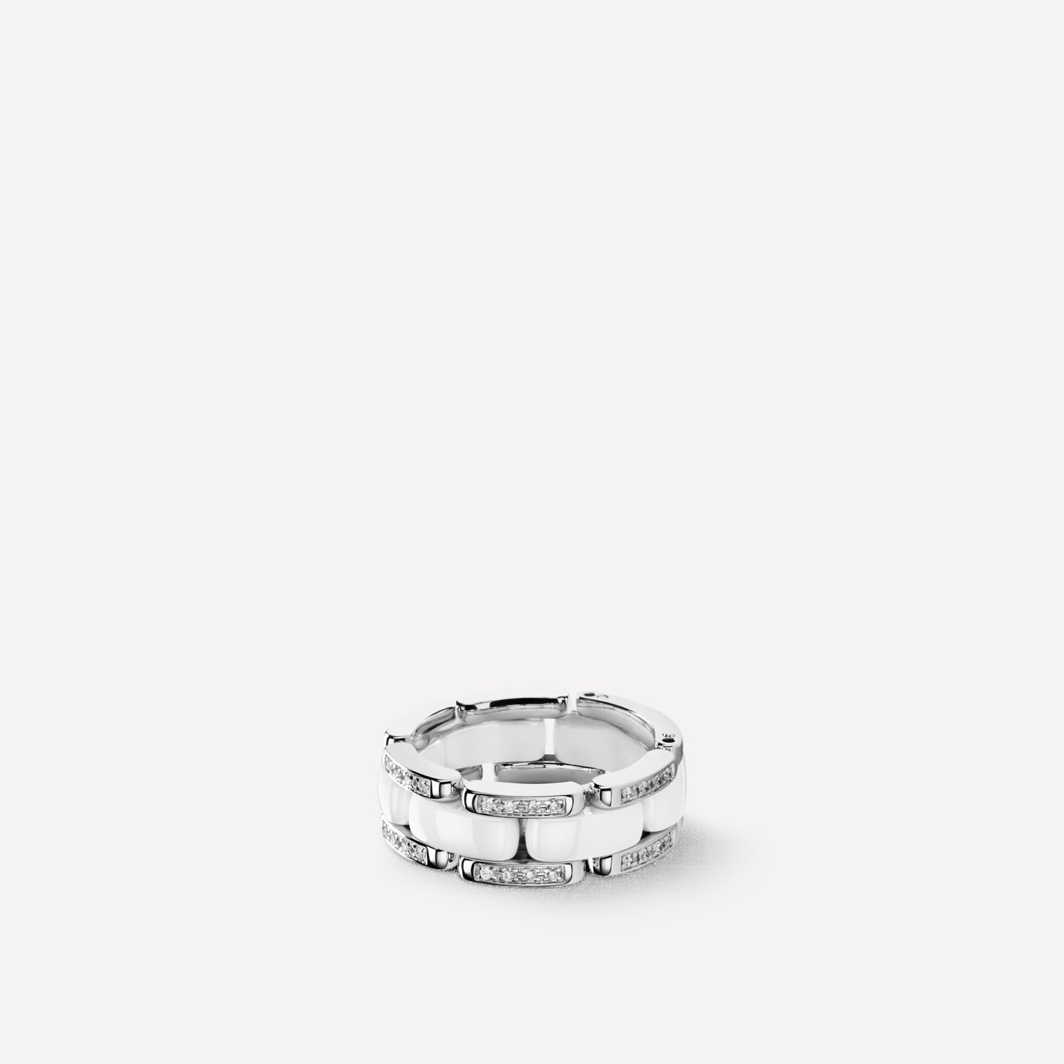 Ultra Ring Ultra ring in white ceramic, 18K white gold and diamonds. Medium, flexible version.